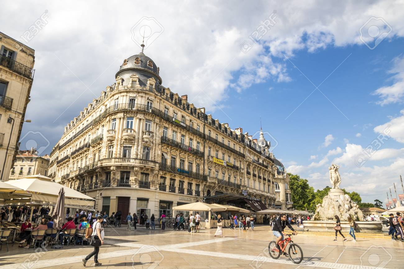 Montpellier, France. The Place de la Comedie, a historic square, with the Fountain of Three Graces and the Le Scaphandrier building - 106812950