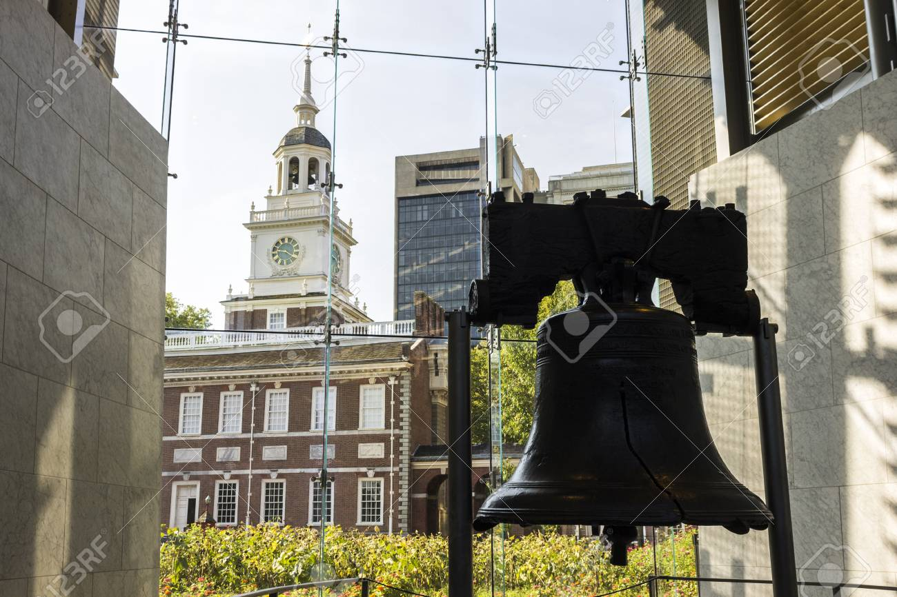 Philadelphia, Pennsylvania. The Liberty Bell, an iconic symbol of American independence, with the Independence Hall in the background - 104471457