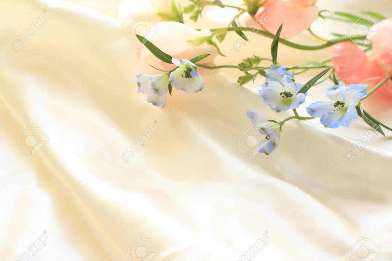 Delphinium And Sweet Pea On Silk For Background Image Stock Photo
