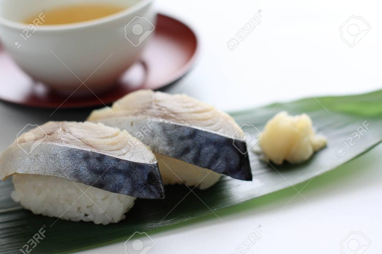 Japanese food, mackerel Sushi and green tea Stock Photo - 22845138