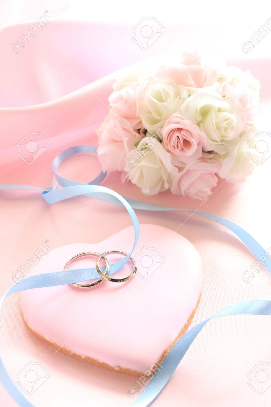 Wedding Rings On Pink Icing Cookie In Heart Shape With Flower ...
