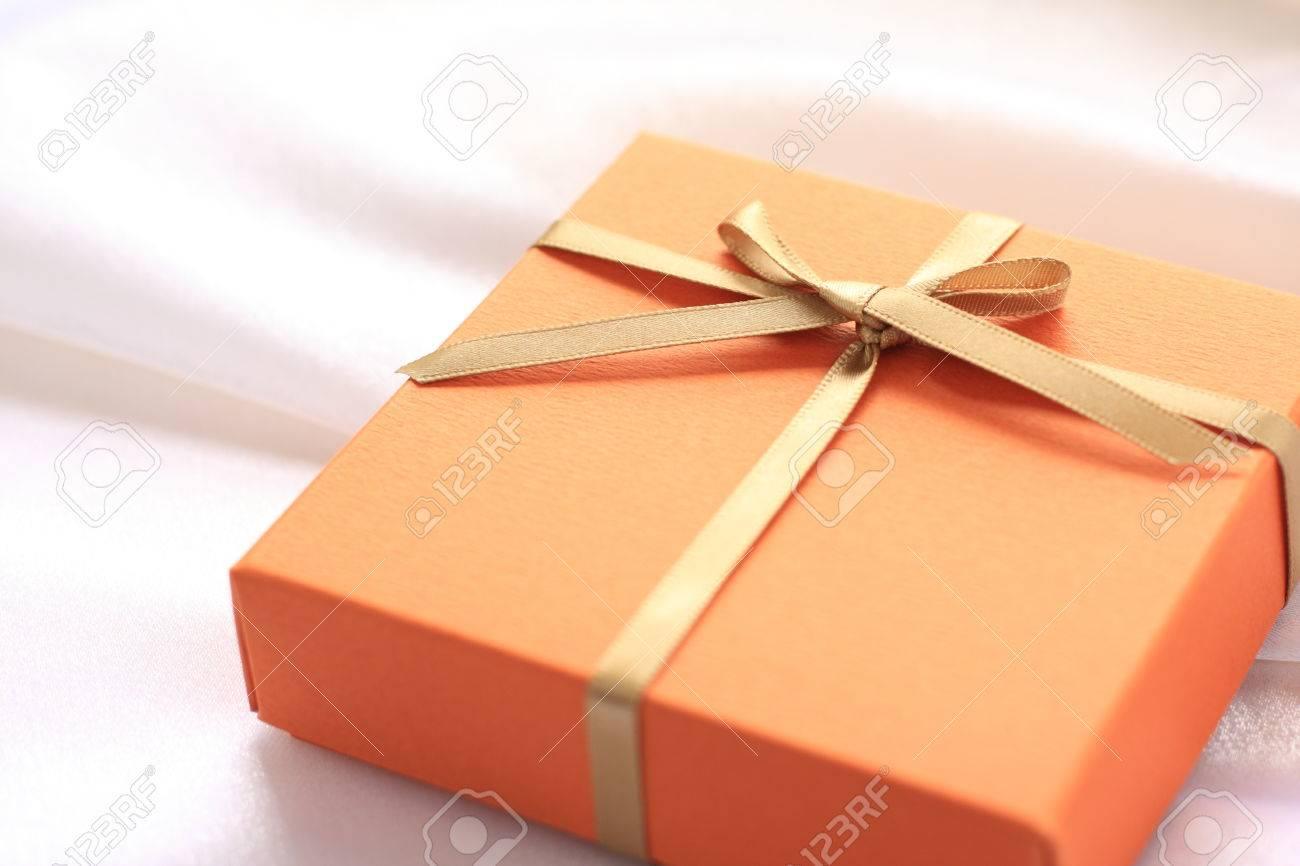Orange color gift box stock photo picture and royalty free image orange color gift box negle Gallery