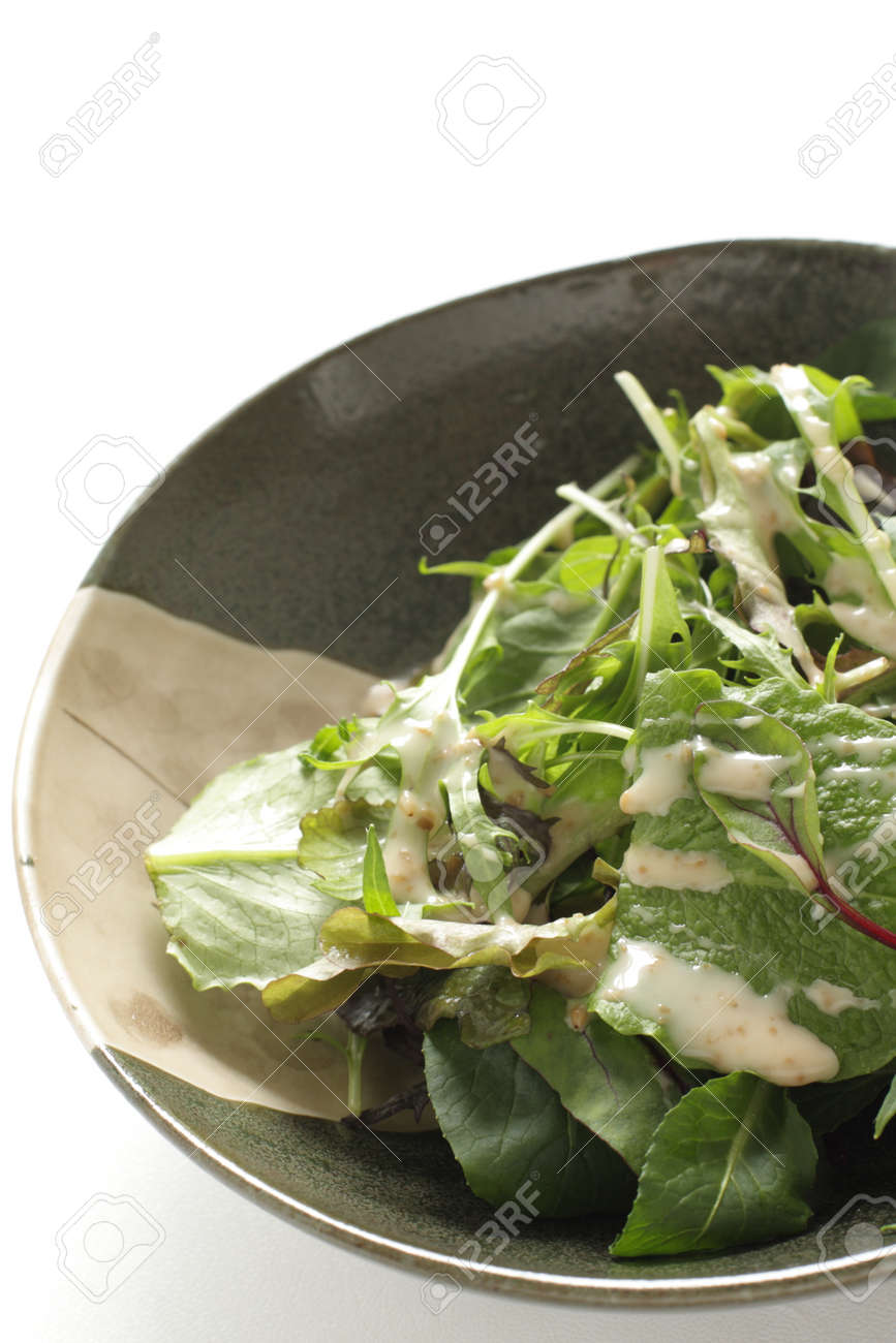 Baby spinach salad in bowl with copy space - 169245898