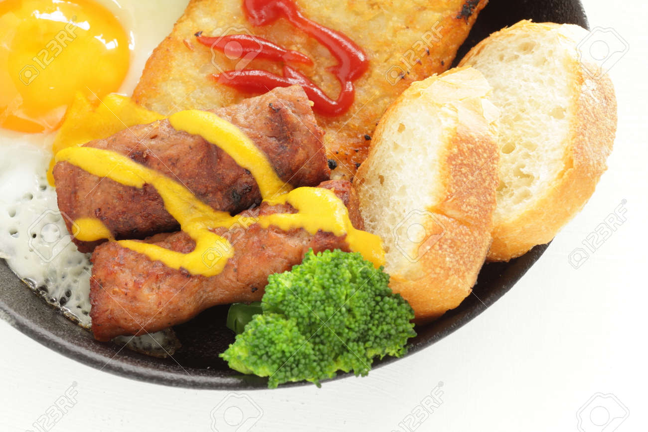 hashed brown and sausage with sunny side up fried egg for gourmet breakfast - 169245900