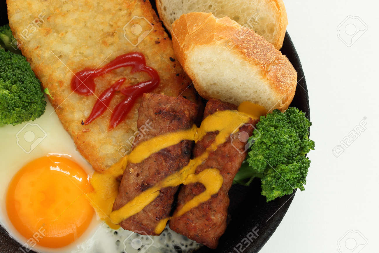 hashed brown and sausage with sunny side up fried egg for gourmet breakfast - 169245939