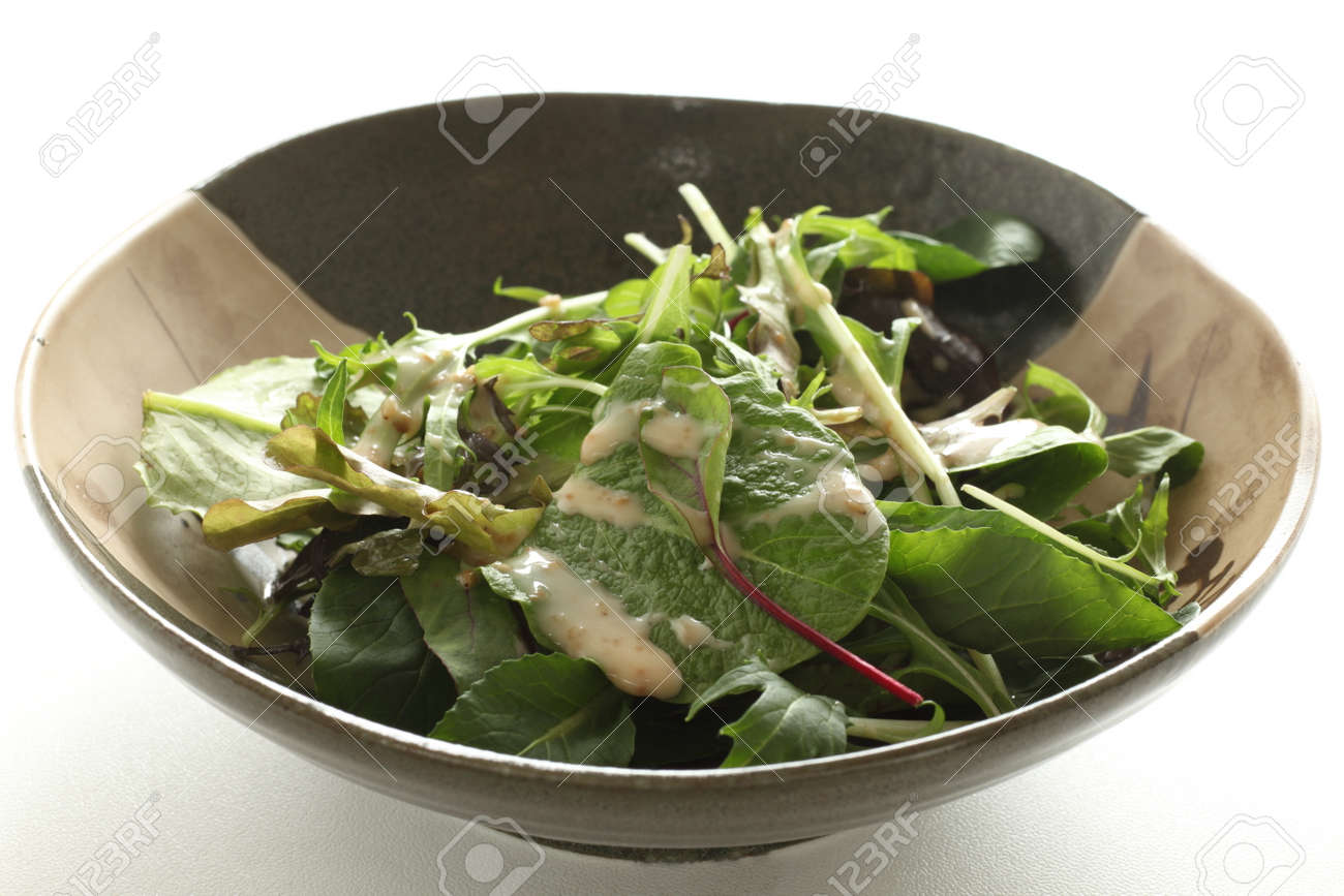 Baby spinach salad in bowl with copy space - 169245940