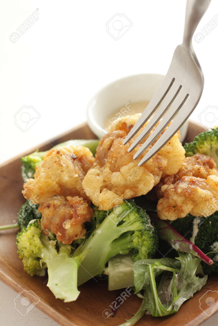 Fried chicken served with boiled broccoli - 168772422
