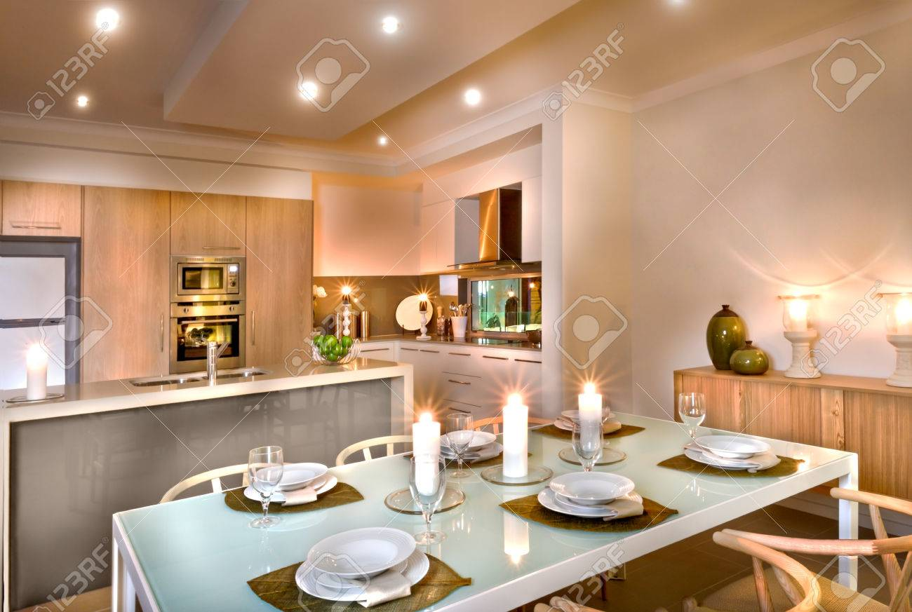 Genial Modern Kitchen And The Dining Room With White Candles Everywhere, Wine  Glasses And Dishes On
