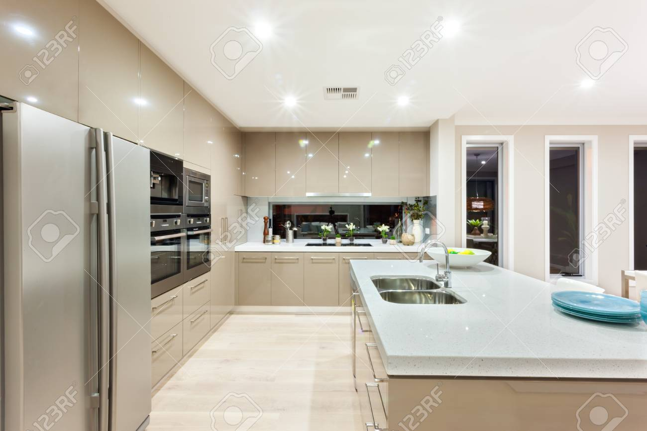 Indoor Of The Luxury Kitchen Includes A Fridge And Wall Ovens ...