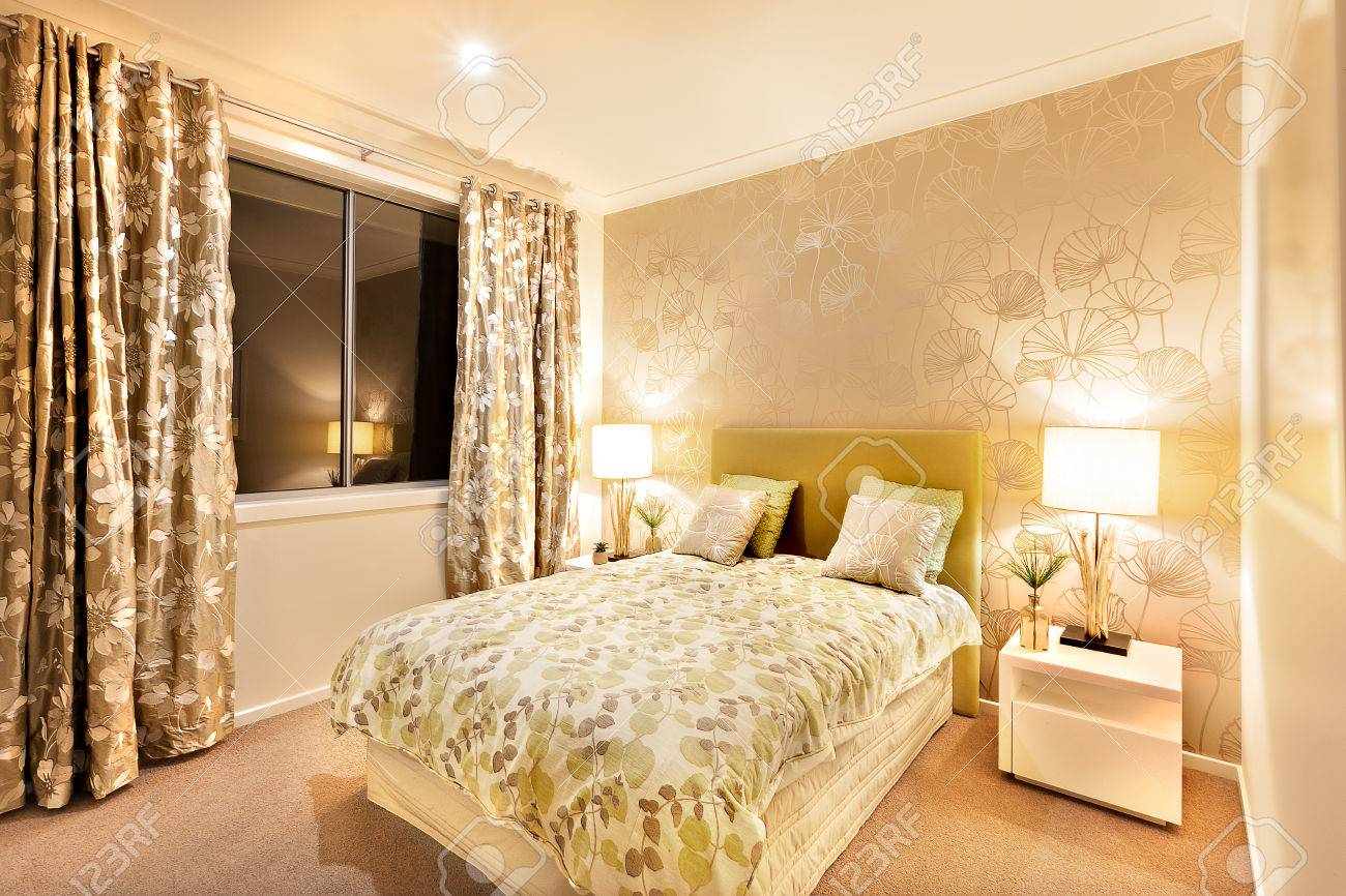 Beautiful bedroom in a luxury hotel or house illuminated wall..