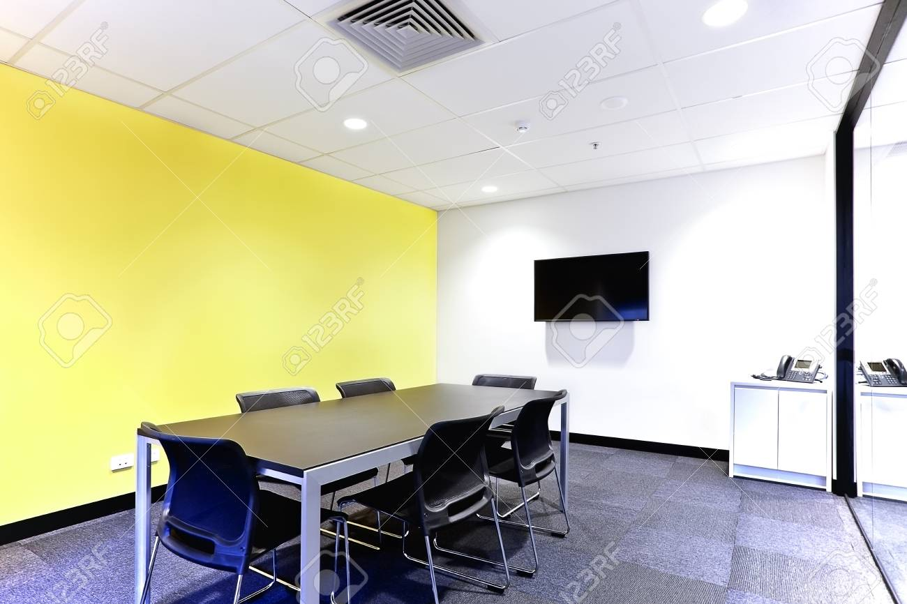 Modern Meeting Room Or Office With White And Yellow Walls On.. Stock ...