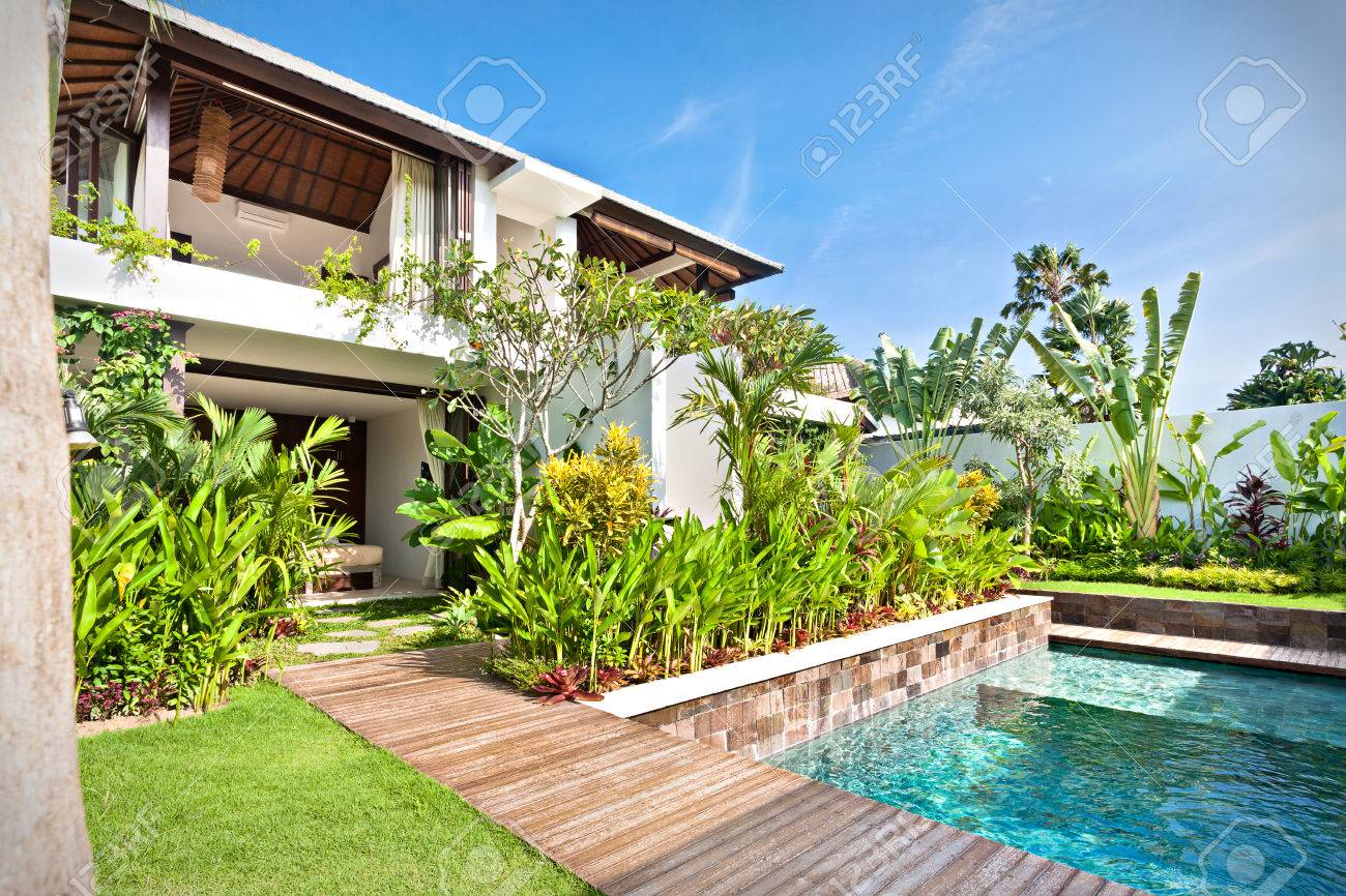Garden With Swimming Pool luxury house with a swimming pool and a garden with lawn and..