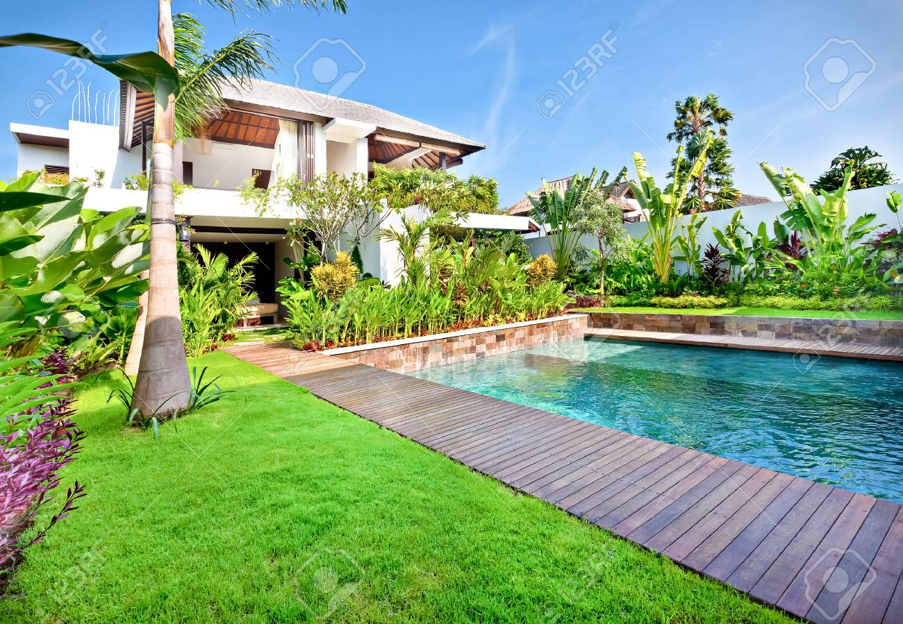 Garden With Swimming Pool green lawn with a garden including swimming pool in a modern..