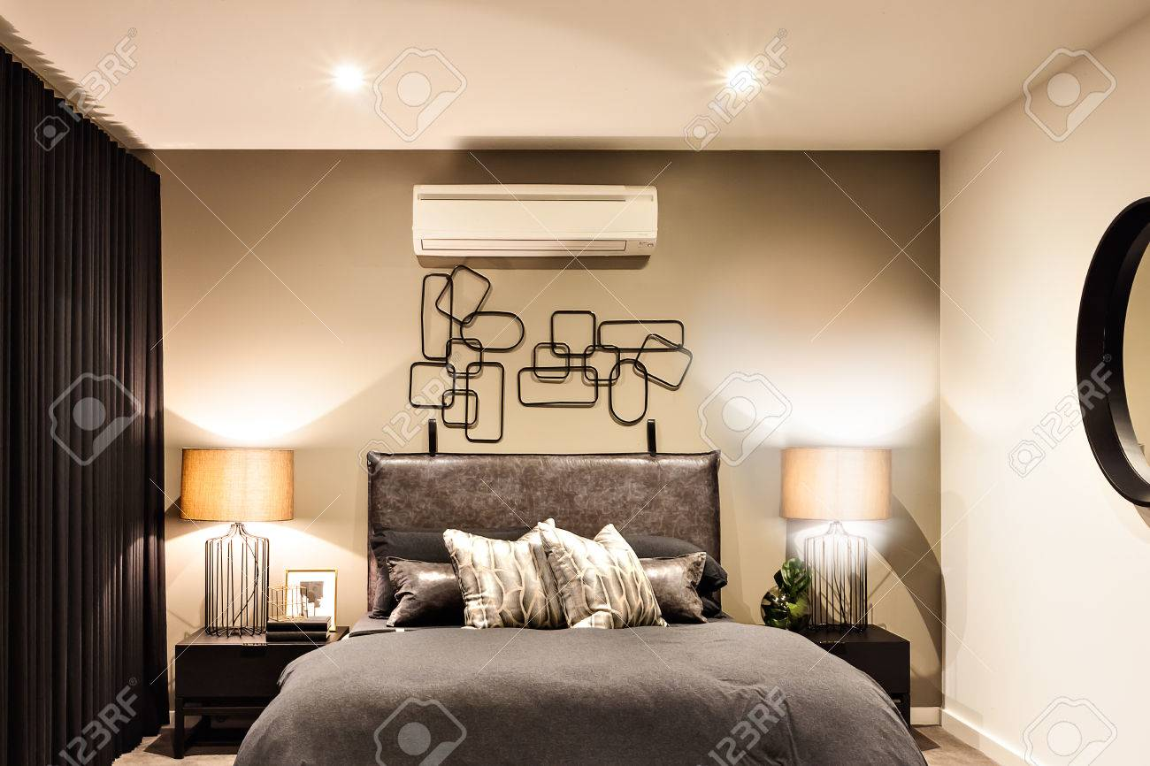 Modern bedroom included flashing table lamps with air conditioner..
