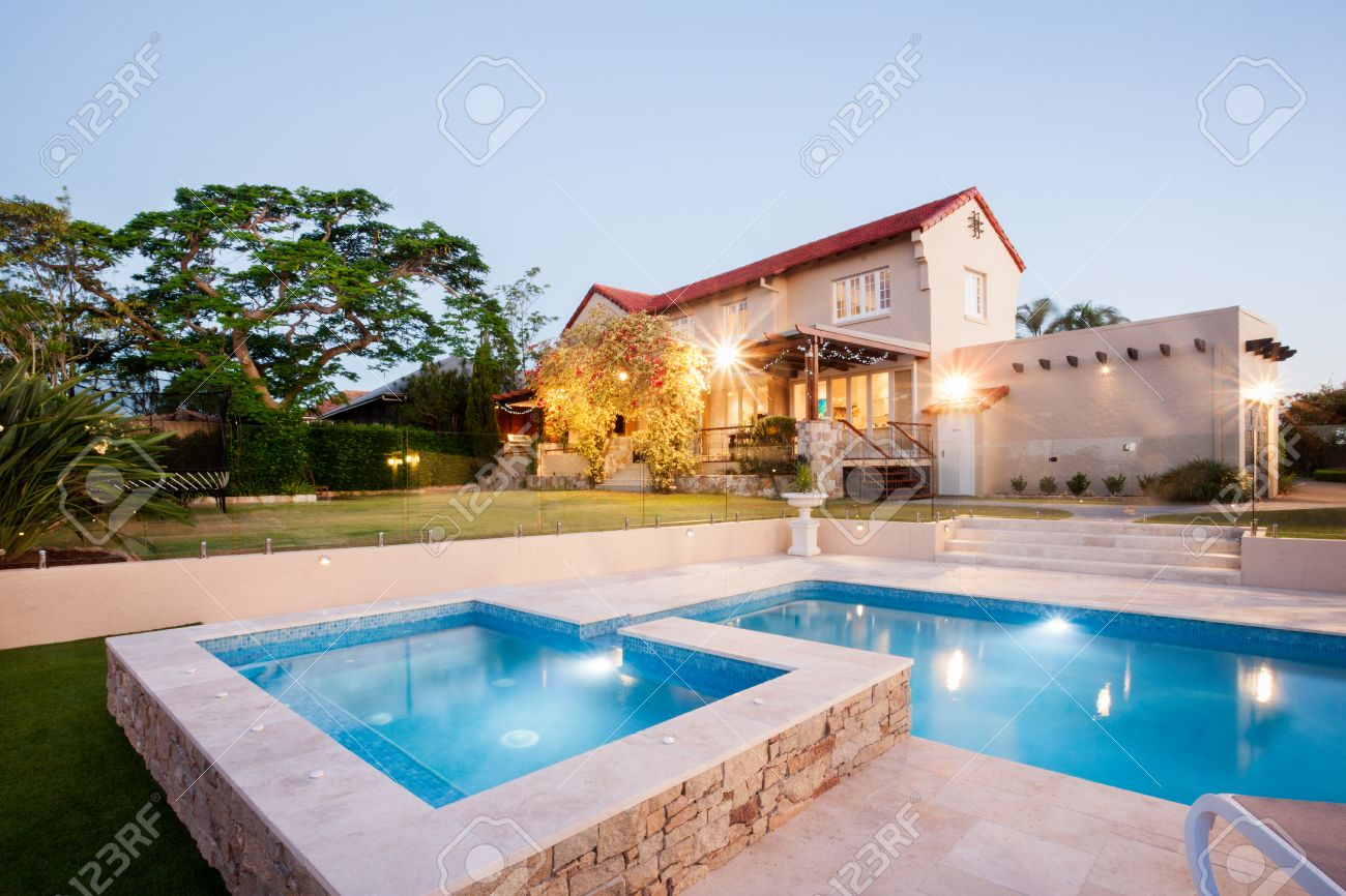 Luxury House Garden Decoration With A Swimming Pool Side With Flashing  Lights In Front Of The