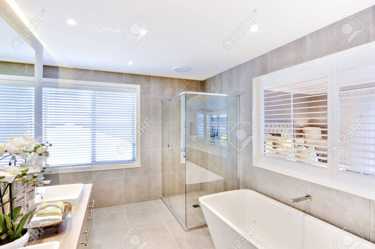 Modern Bathroom With A Washbasin And Shower Area Near To White ...