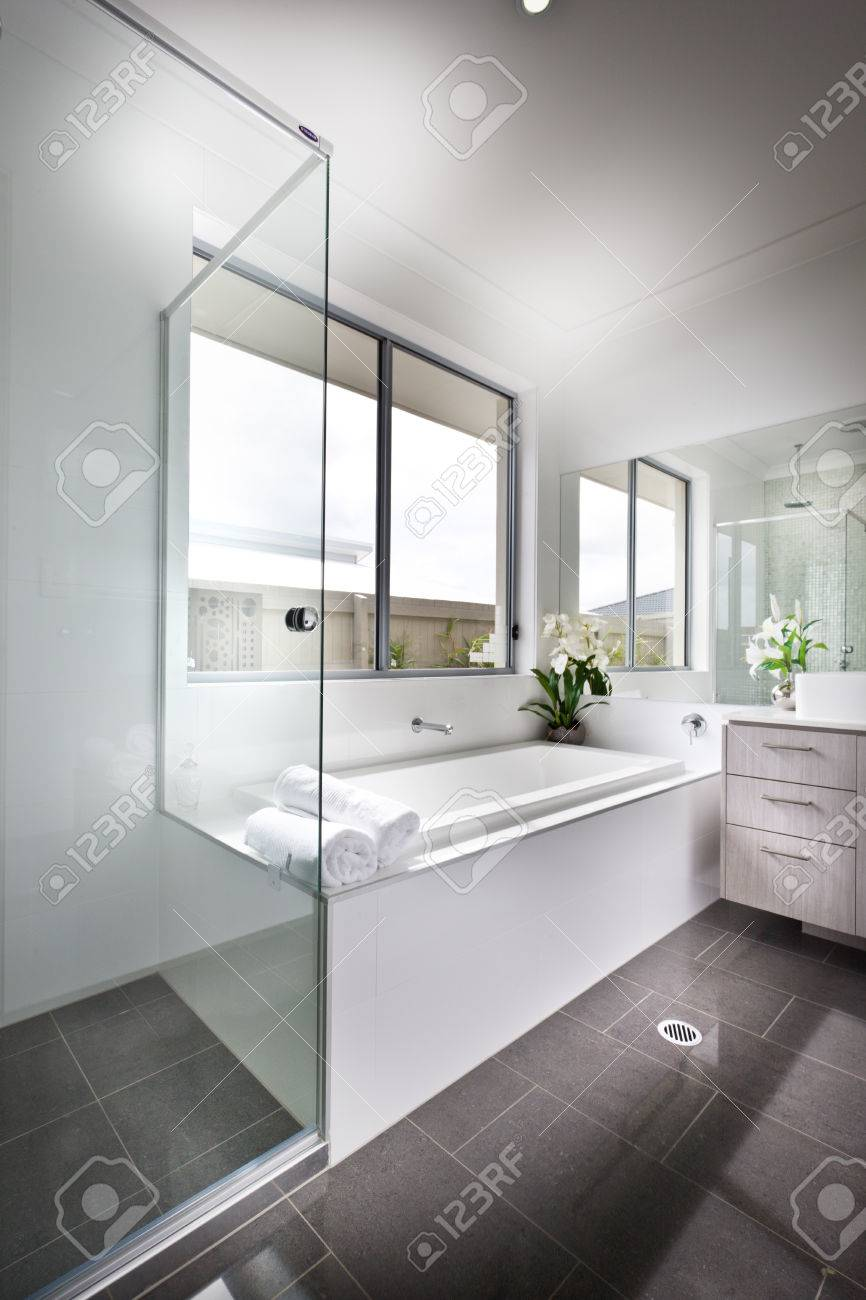 Luxury Bathroom Floor Is Made Of Shiny Tiles. The Bathing Area ...