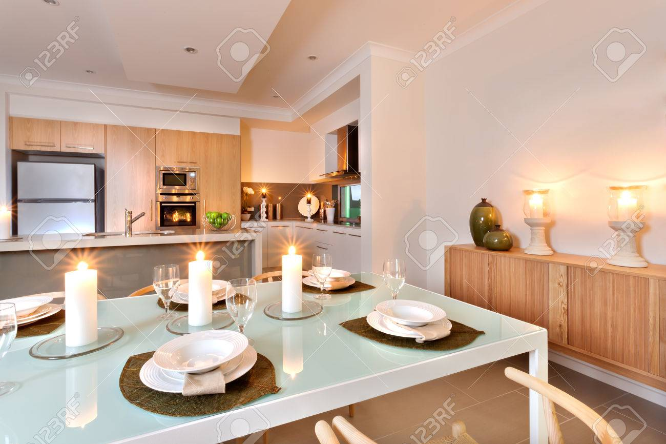 Modern Kitchen Area Included A Refrigerator And A Wall Oven Decorated With  Flashing Candles Around The