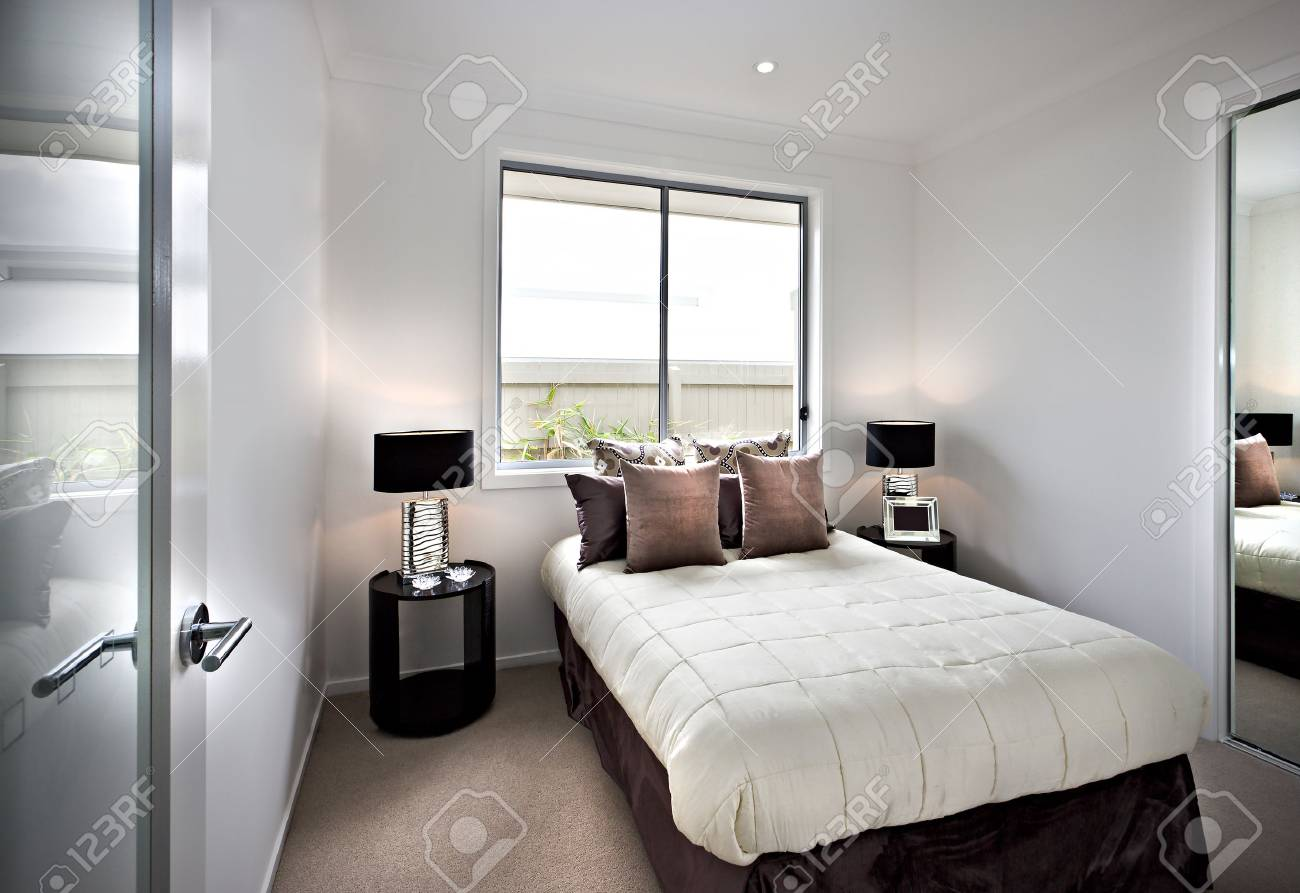 Modern and classic bedroom with windows and attractive lamps..
