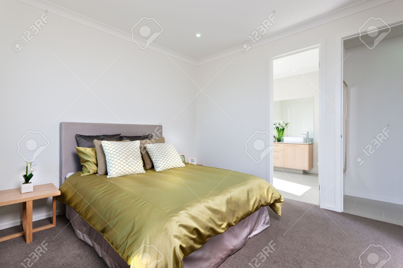 Bedroom With White Walls And A Light Purple Color Carpet Floor