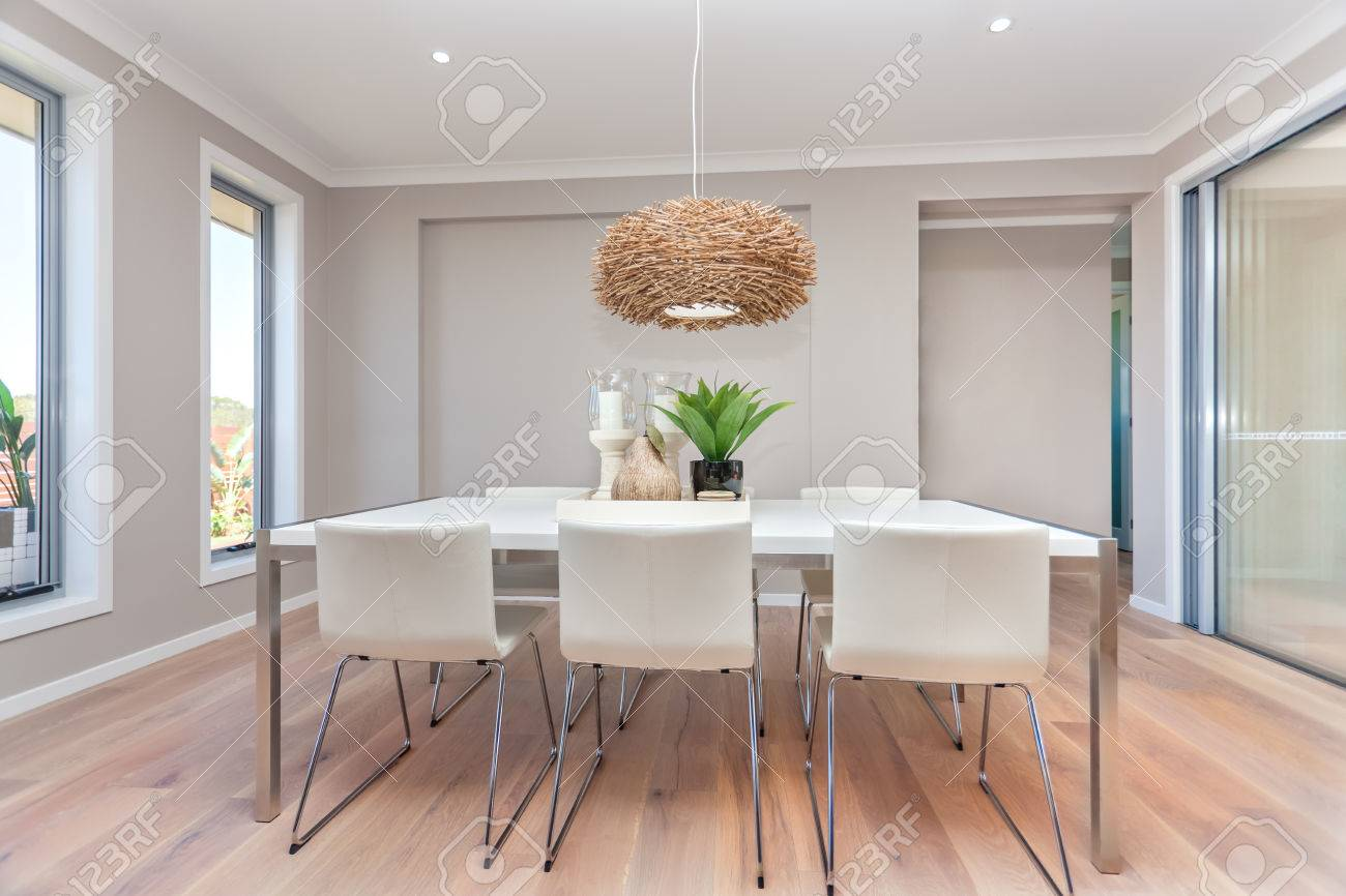 Luxury Dining Room And A Light Color Wooden Floor Gray Walls With Two Windows Around