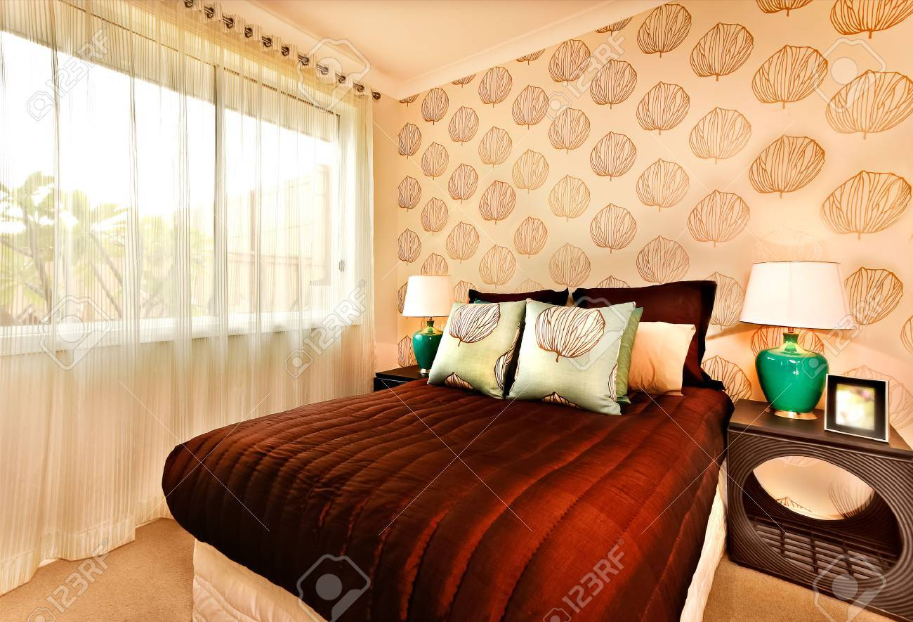 Luxury Bed With Huge Brown Color Mattress And Light Blue Pillows ...
