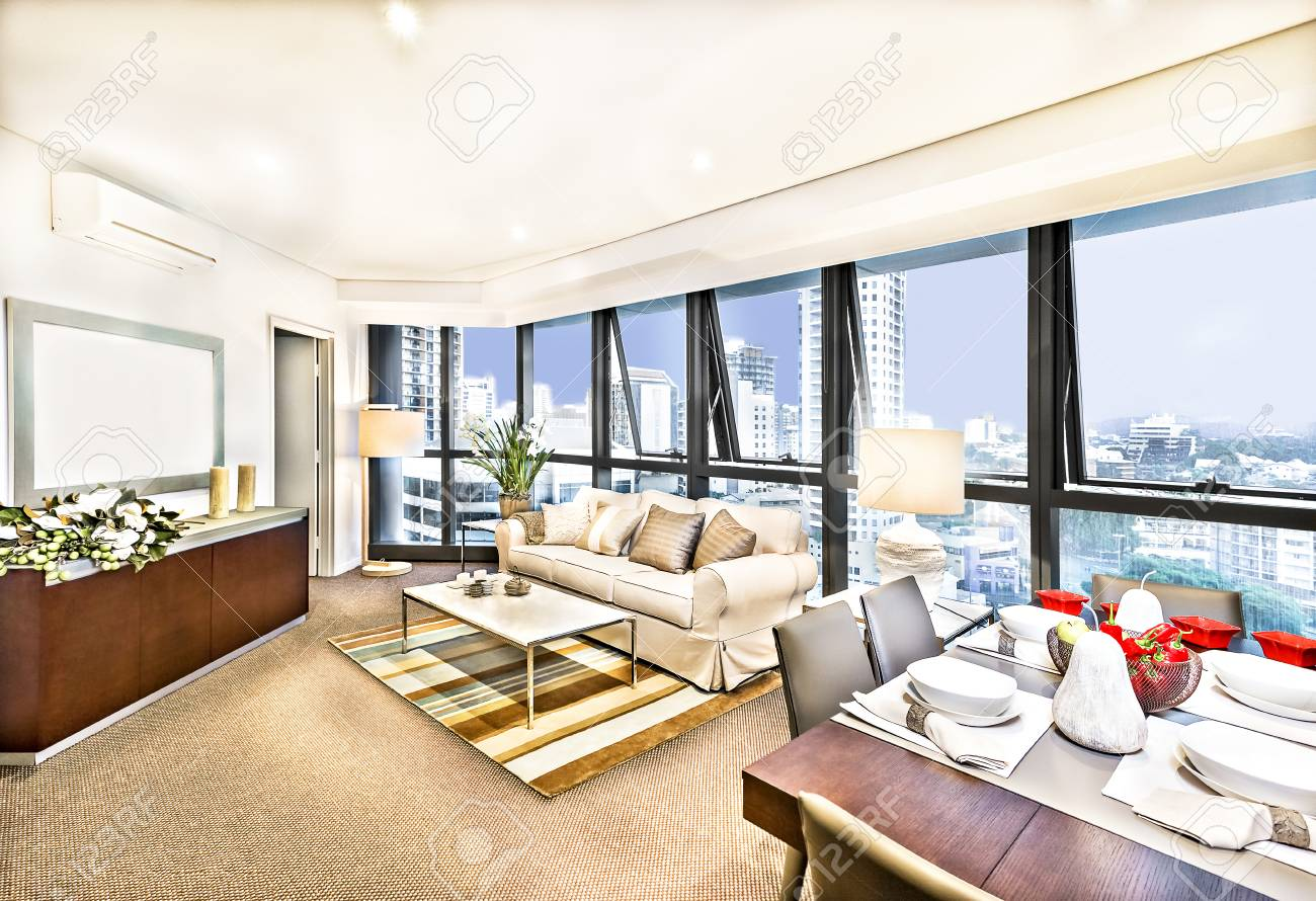 Modern living room interior with sofa set in city, luxurious..