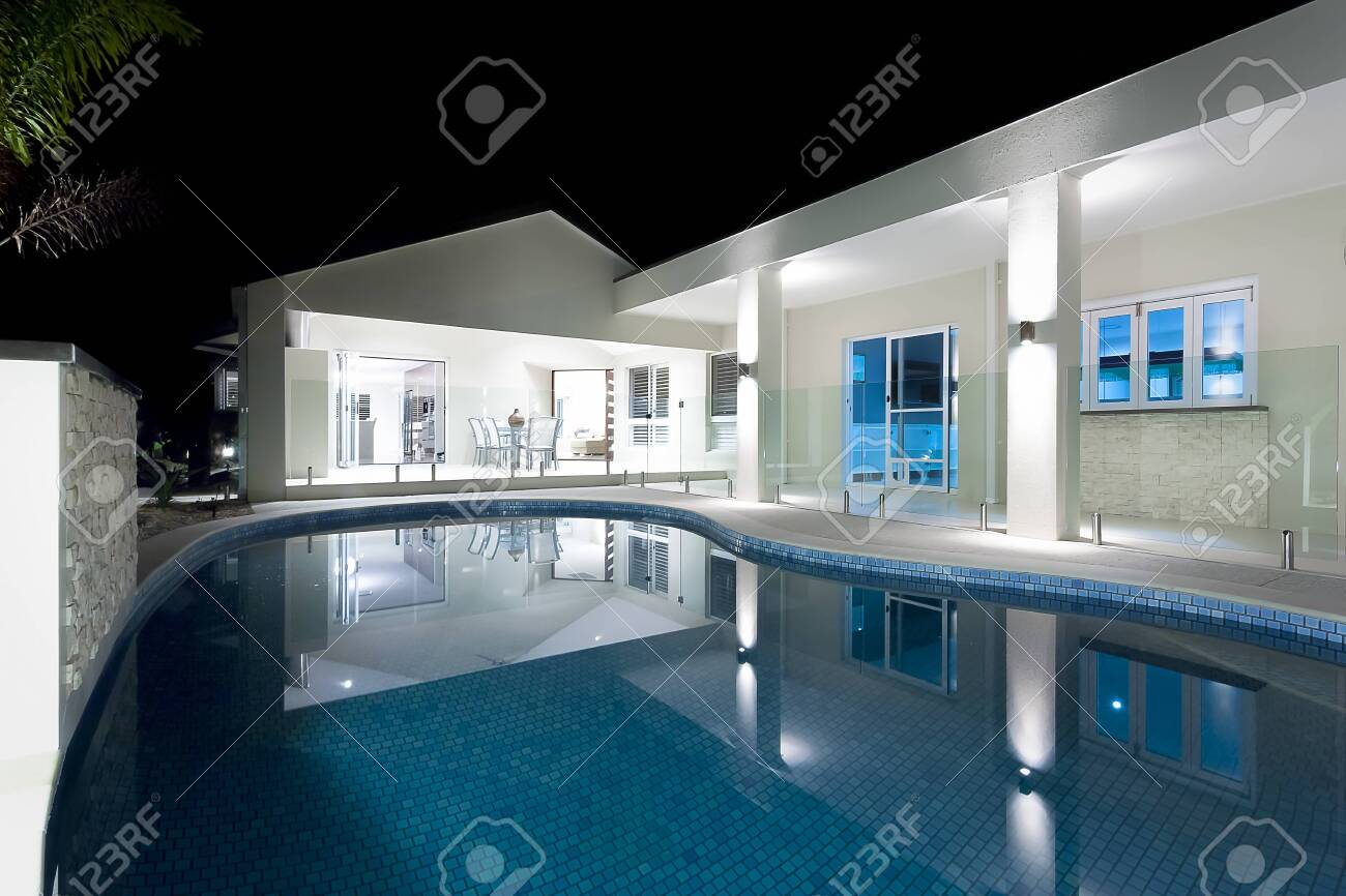 Clear blue water round swimming pool of a modern hotel or house..