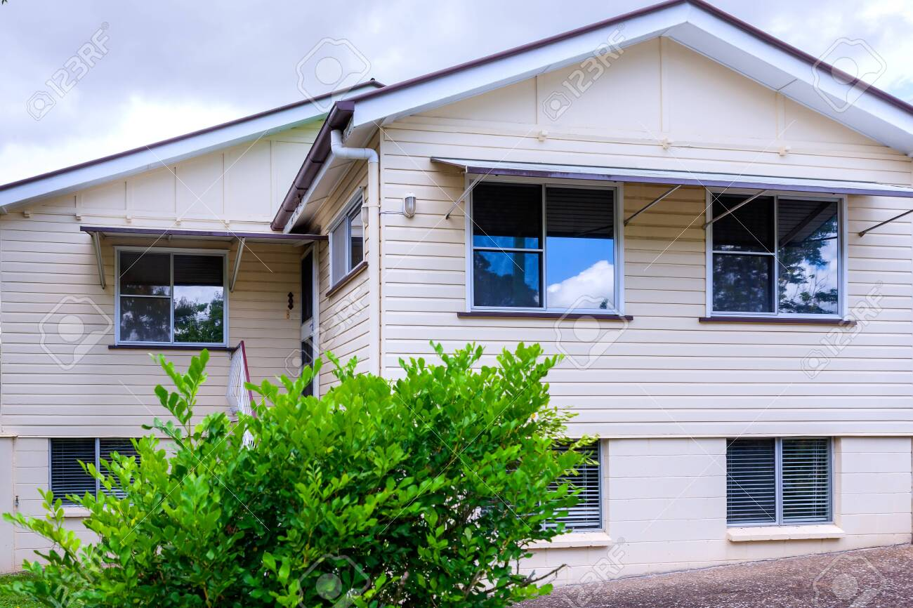 Facade of a regular size, simple house - 124184681