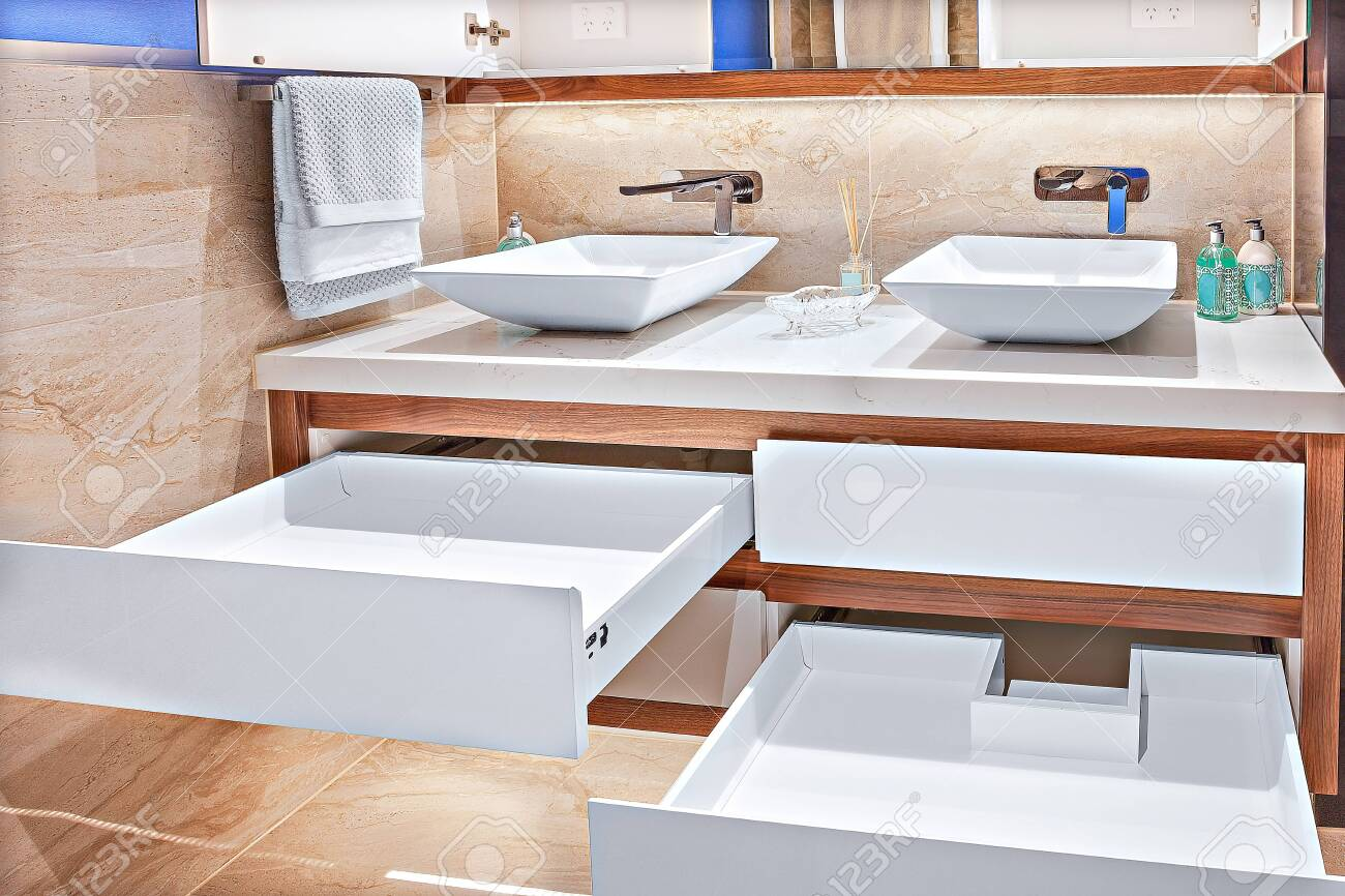 Neatly Designed Vanity Basins With Spacious Cabinets And Designer Stock Photo Picture And Royalty Free Image Image 131803425