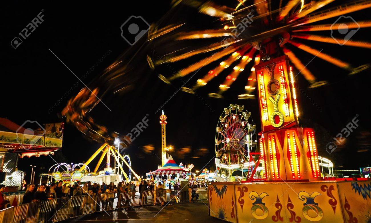 Fair Midway Rides at Night. Stock Photo - 8194736