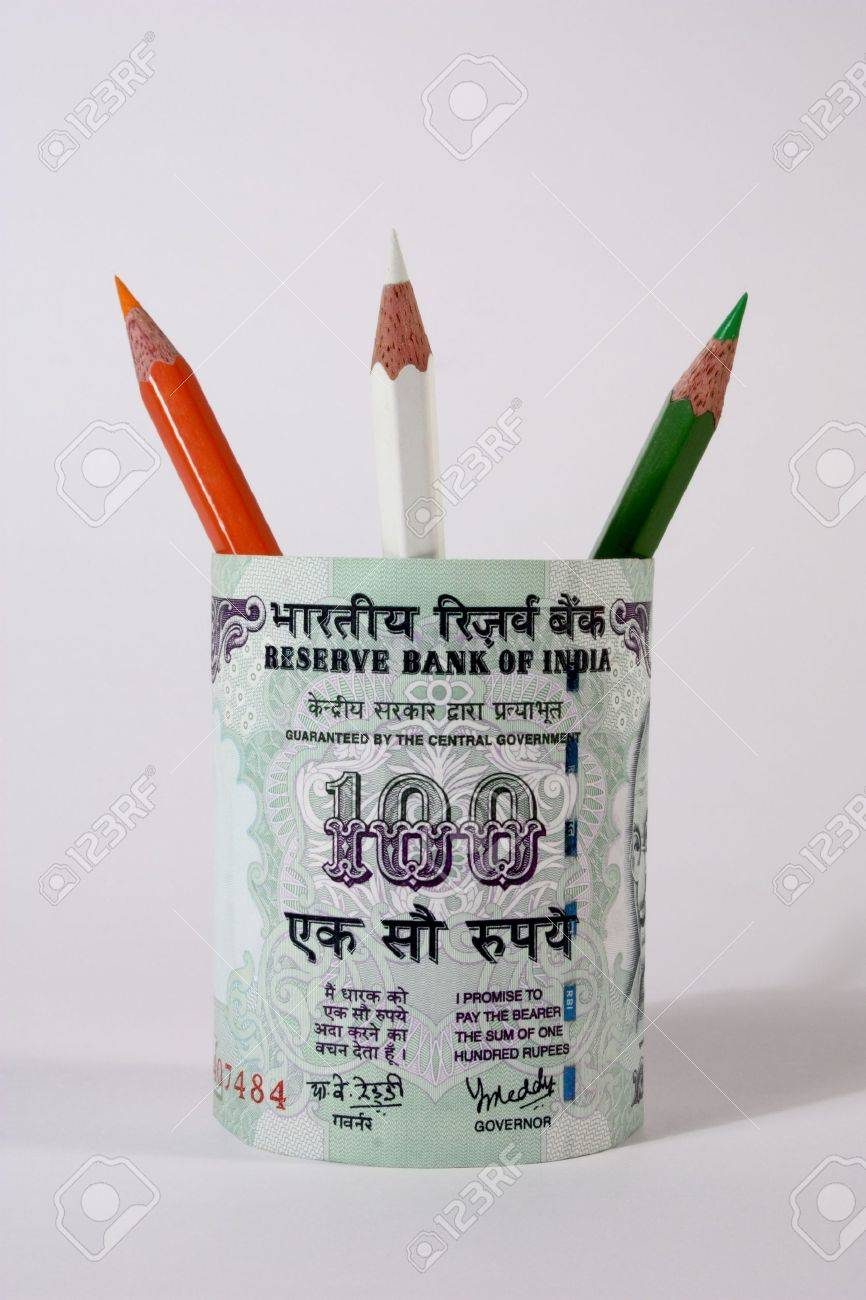 pen stand with indian national color pencils and 100 rupee note