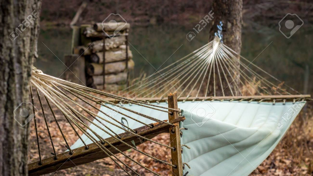 Medium image of broken hammock by the lake stock photo   34576734
