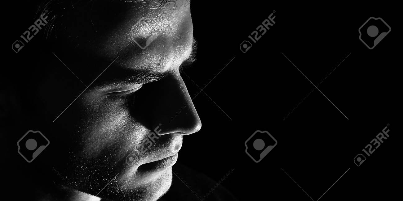 Sad man profile dark guy male in depression black and white