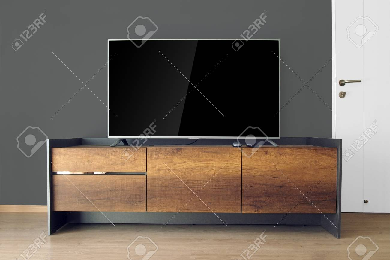 Led Tv On Tv Stand In Empty Room With Black Wall Decorate In