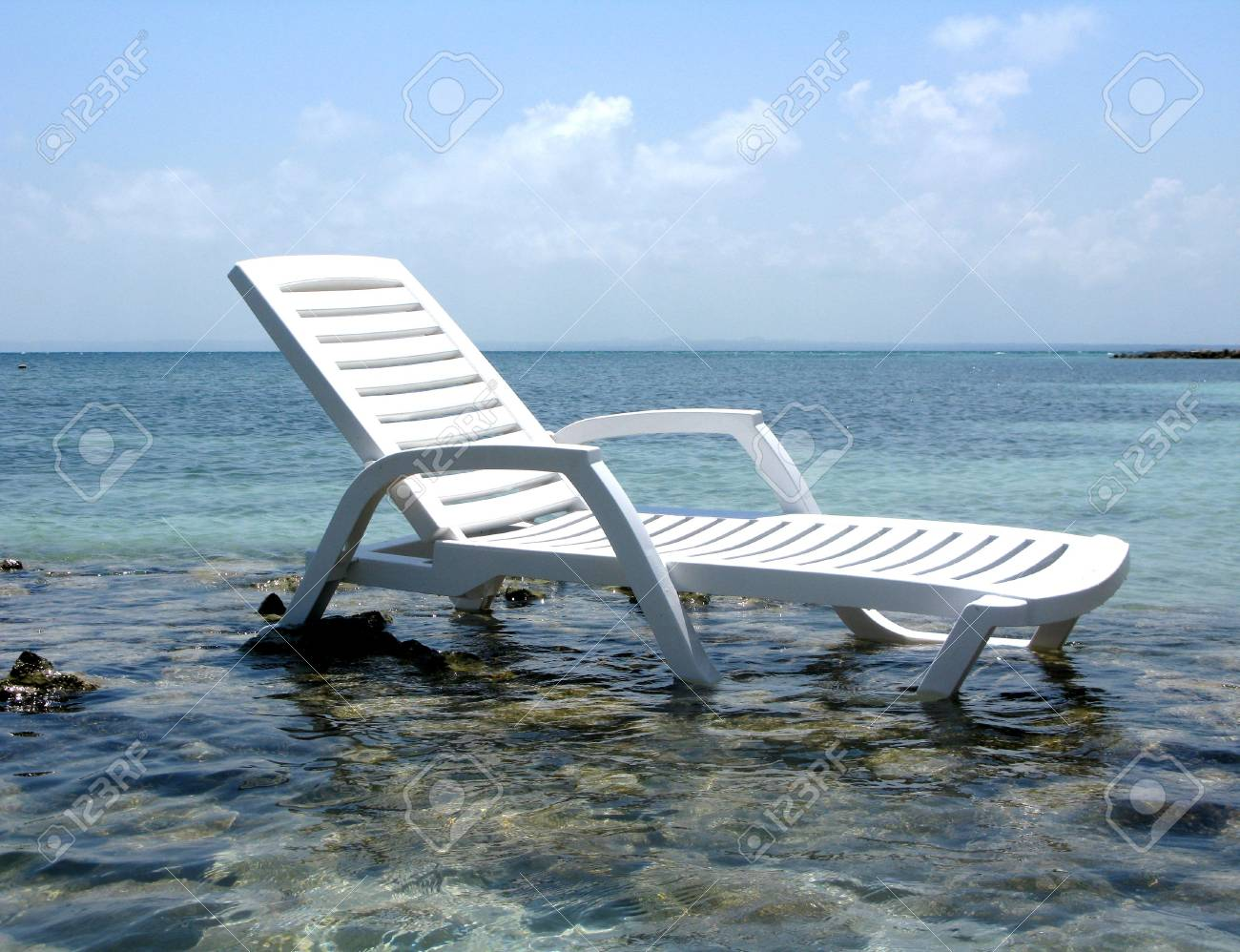Chair on the beach of exotic sea Stock Photo - 3674001