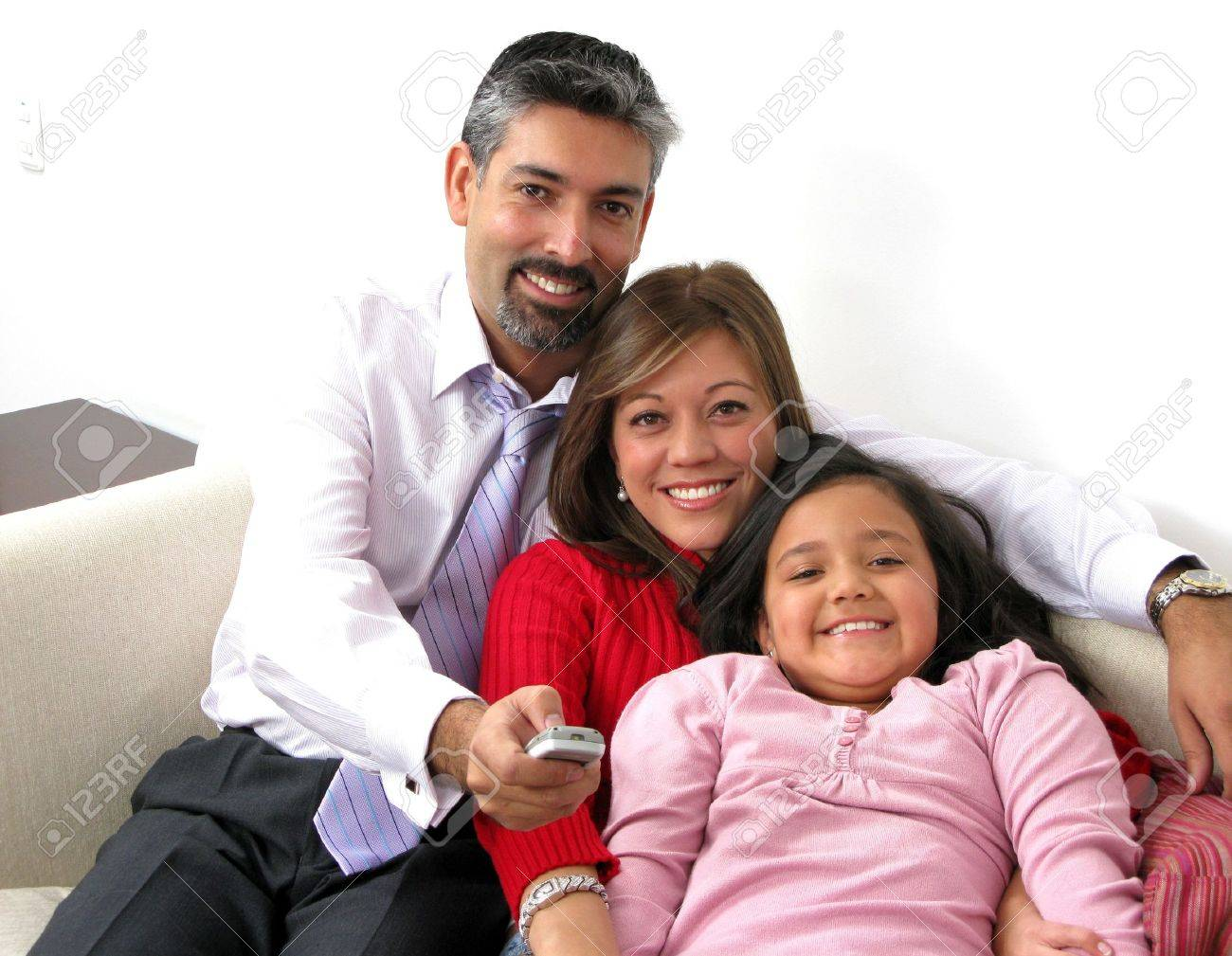 Beautiful happy family with TV remote control Stock Photo - 6410160