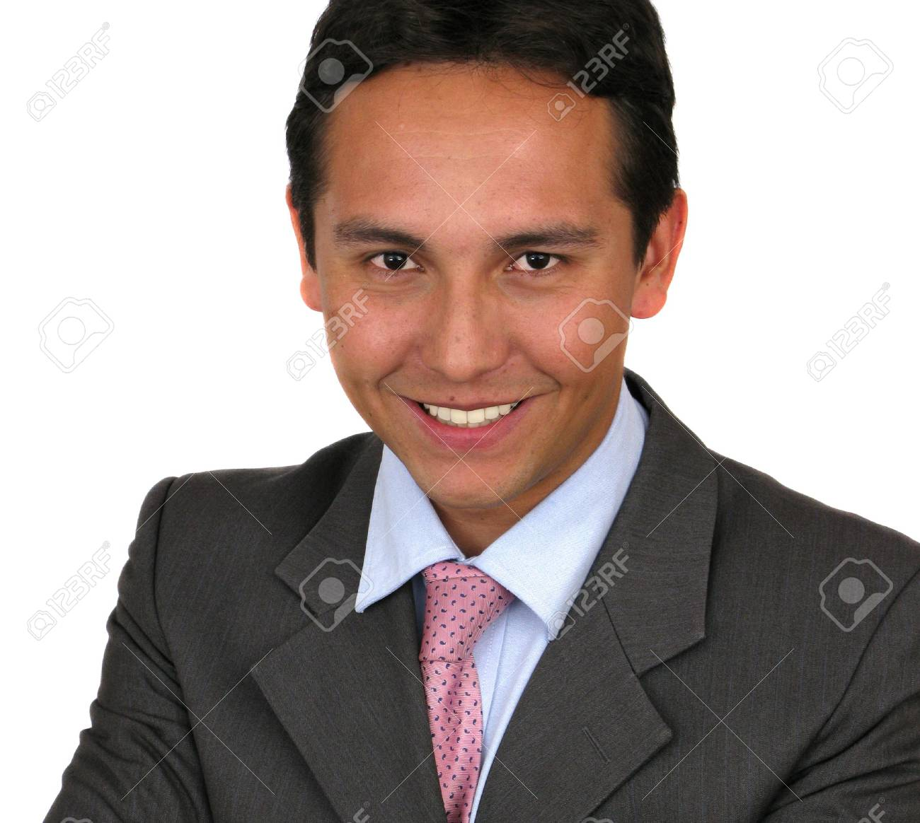 A friendly looking man in a suit with his arms crossed over white Stock Photo - 7313571