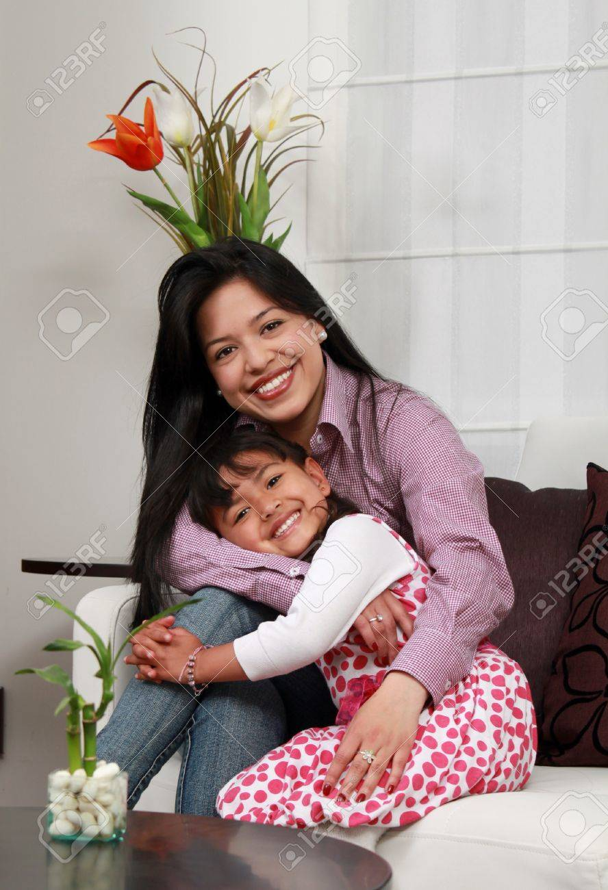mother and girl smiling in the living room Stock Photo - 12868317
