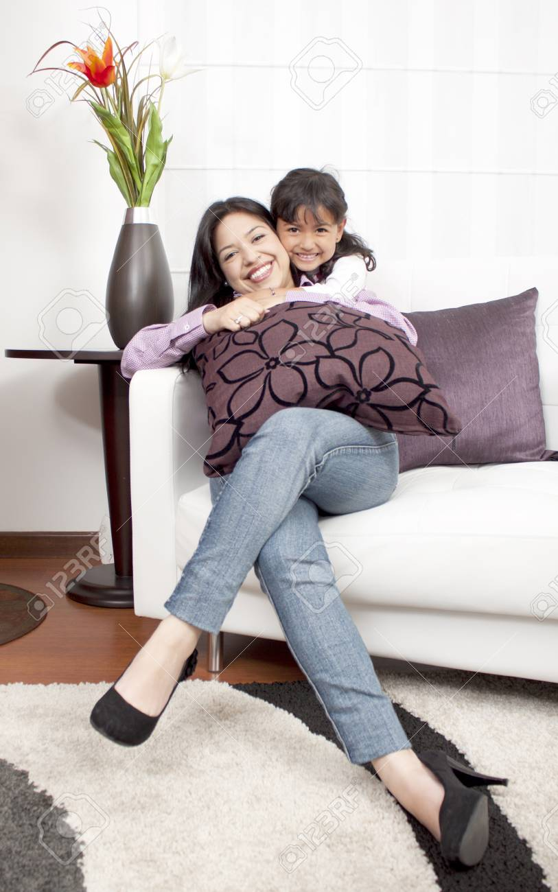 mother and girl smiling in the room Stock Photo - 14902650