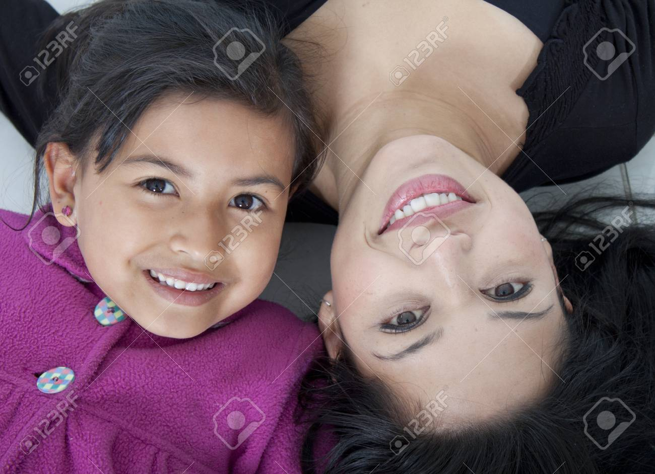 Beautiful mother and daugther on the floor white Stock Photo - 23256157