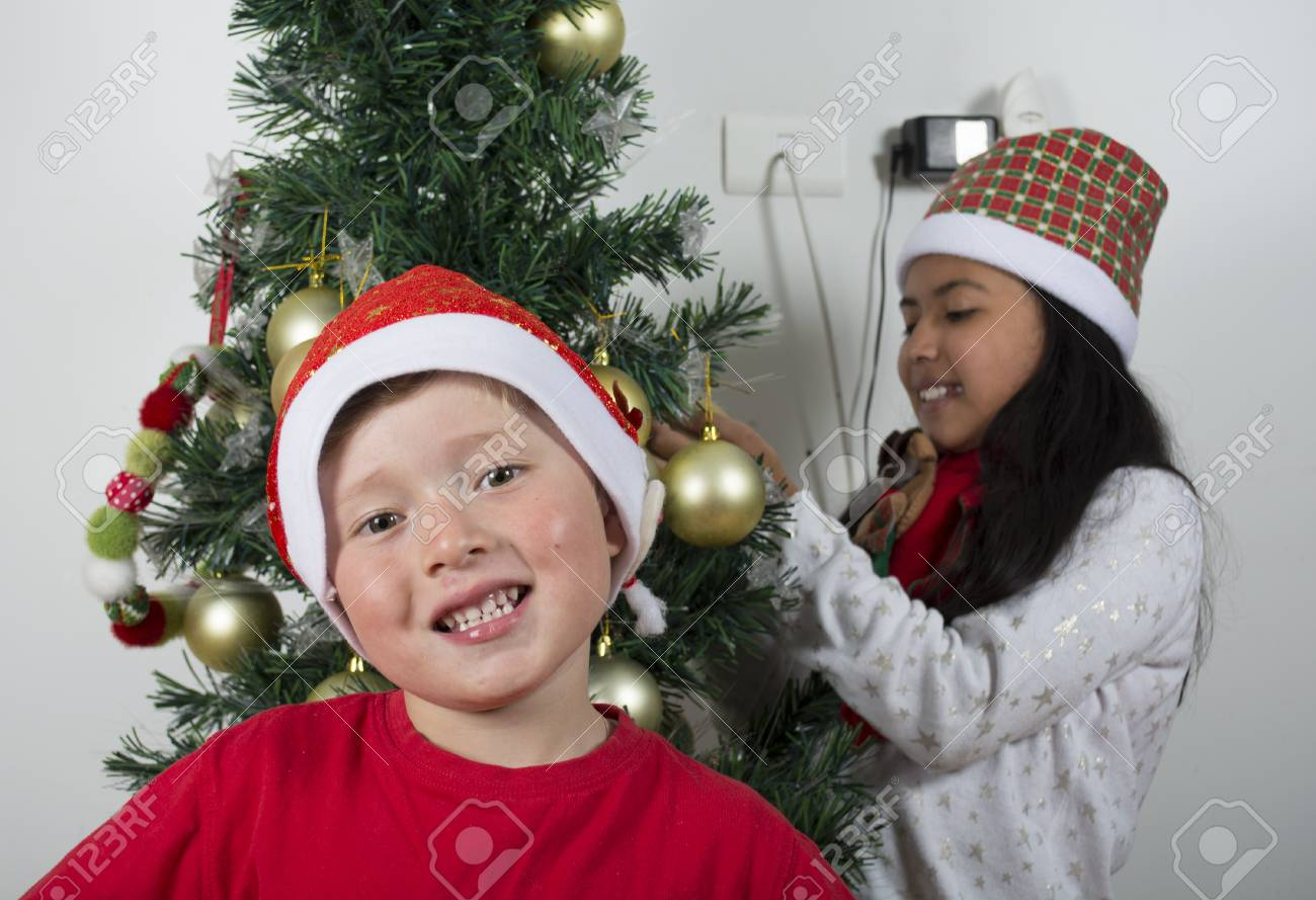 Happy Kids Laying Under The Christmas Tree With A White Stock Photo Picture And Royalty Free Image Image 89999814