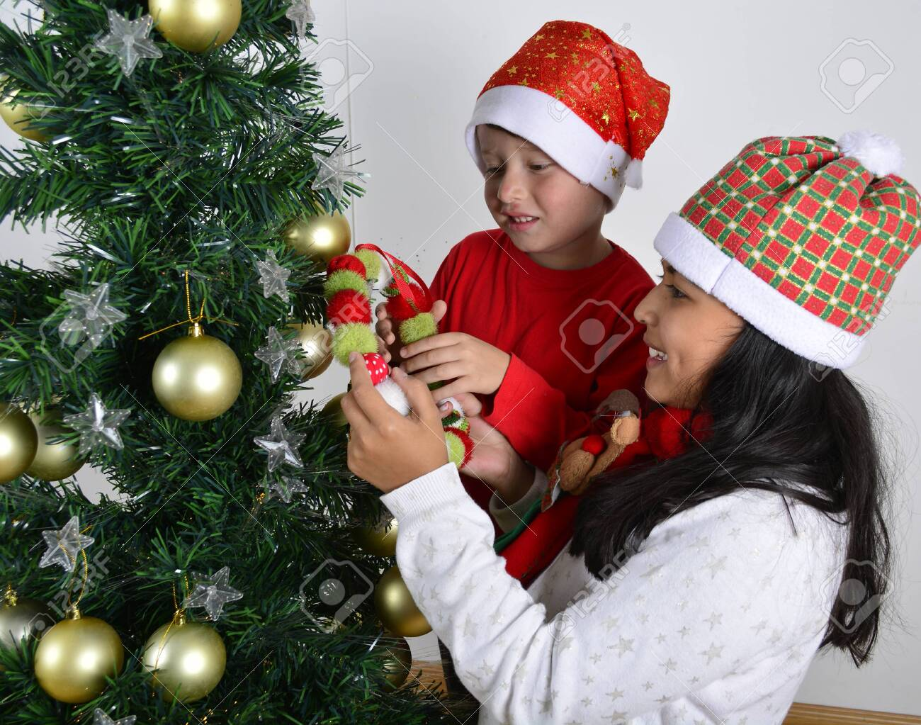 Happy Kids Laying Under The Christmas Tree With A White Stock Photo Picture And Royalty Free Image Image 122181555