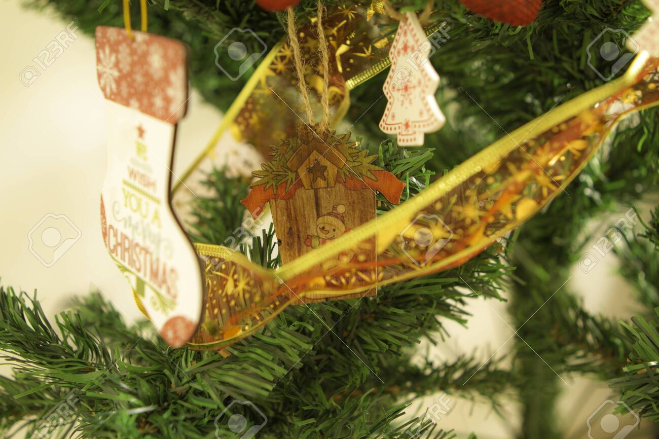 Christmas Tree Close Up Detail Gold Green And White Wood Ornament Stock Photo Picture And Royalty Free Image Image 153110574