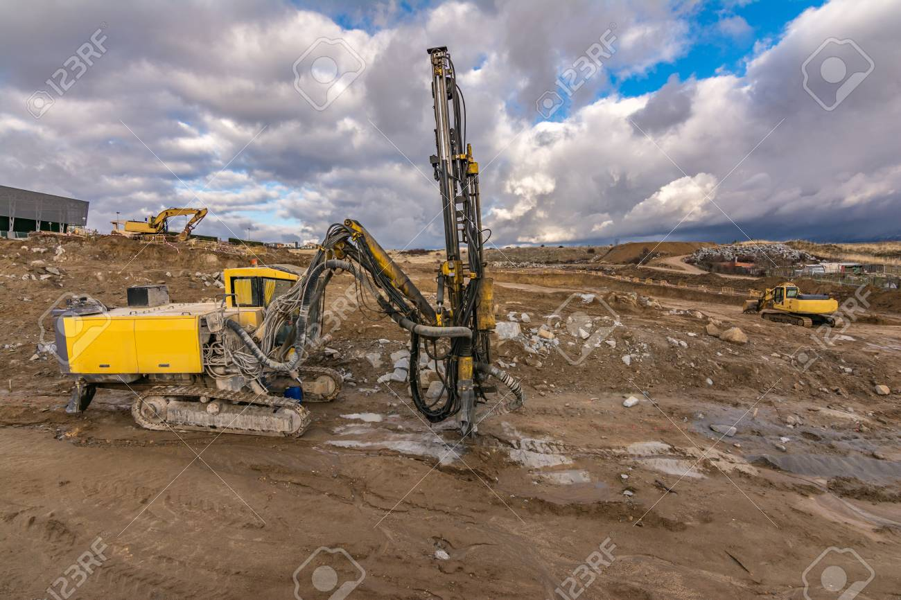 Drilling machine and excavators in a workplace - 120385832
