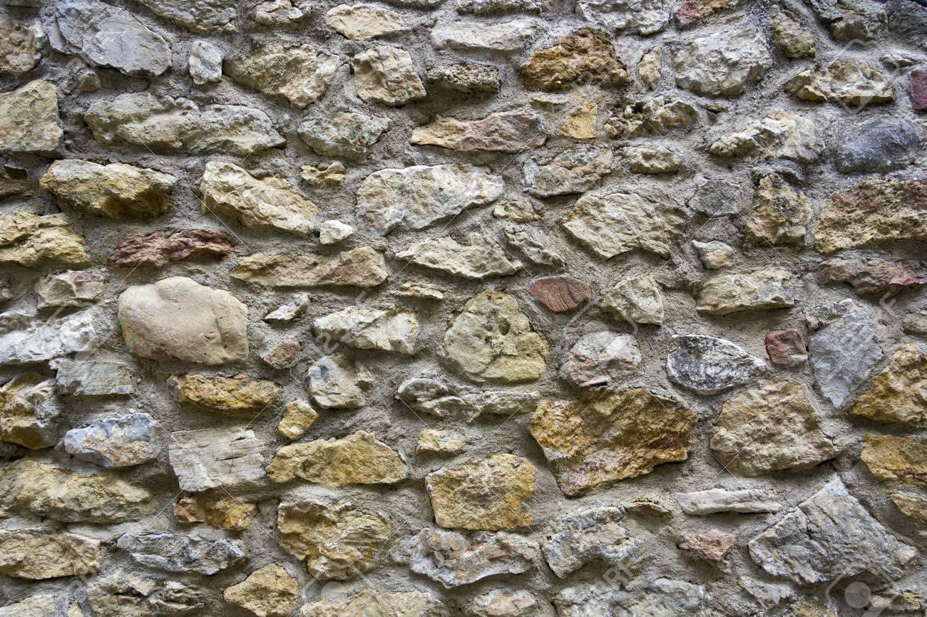 foto de archivo la textura de las paredes de piedra natural se puede utilizar como fondo o la textura para sus proyectos en programas de diseo grfico