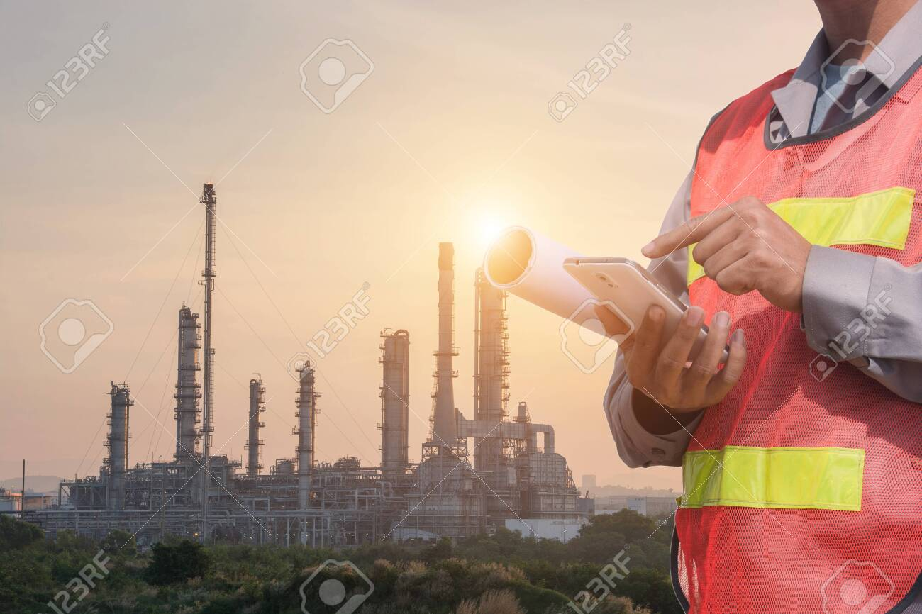 Double exposure of Engineer or Technician man with safety helmet
