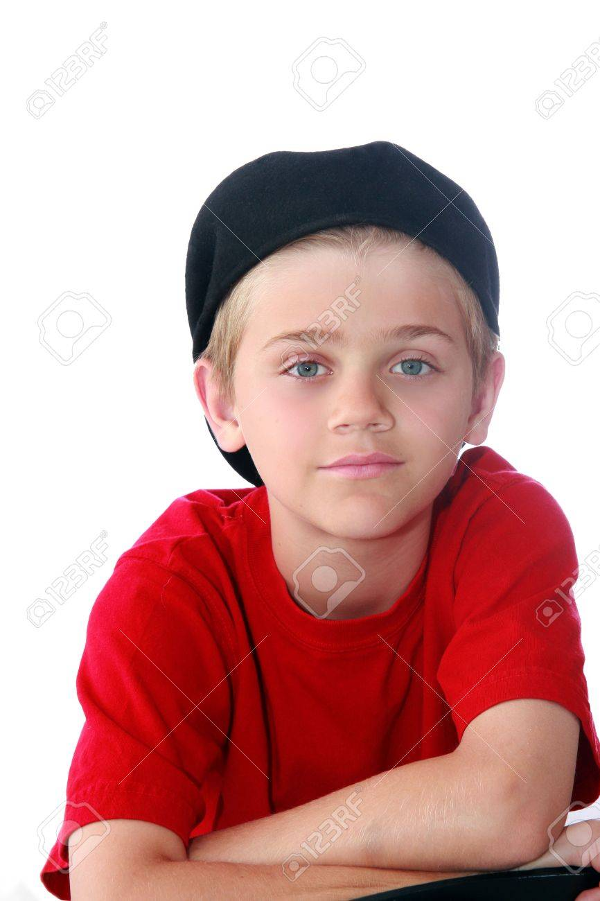black preteen Cute blue eyed preteen boy with red shirt and black cap isolated on white.  Stock