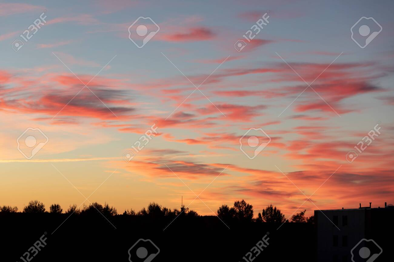 Beautiful vivid color sunset clouds after sunset background - 122720495