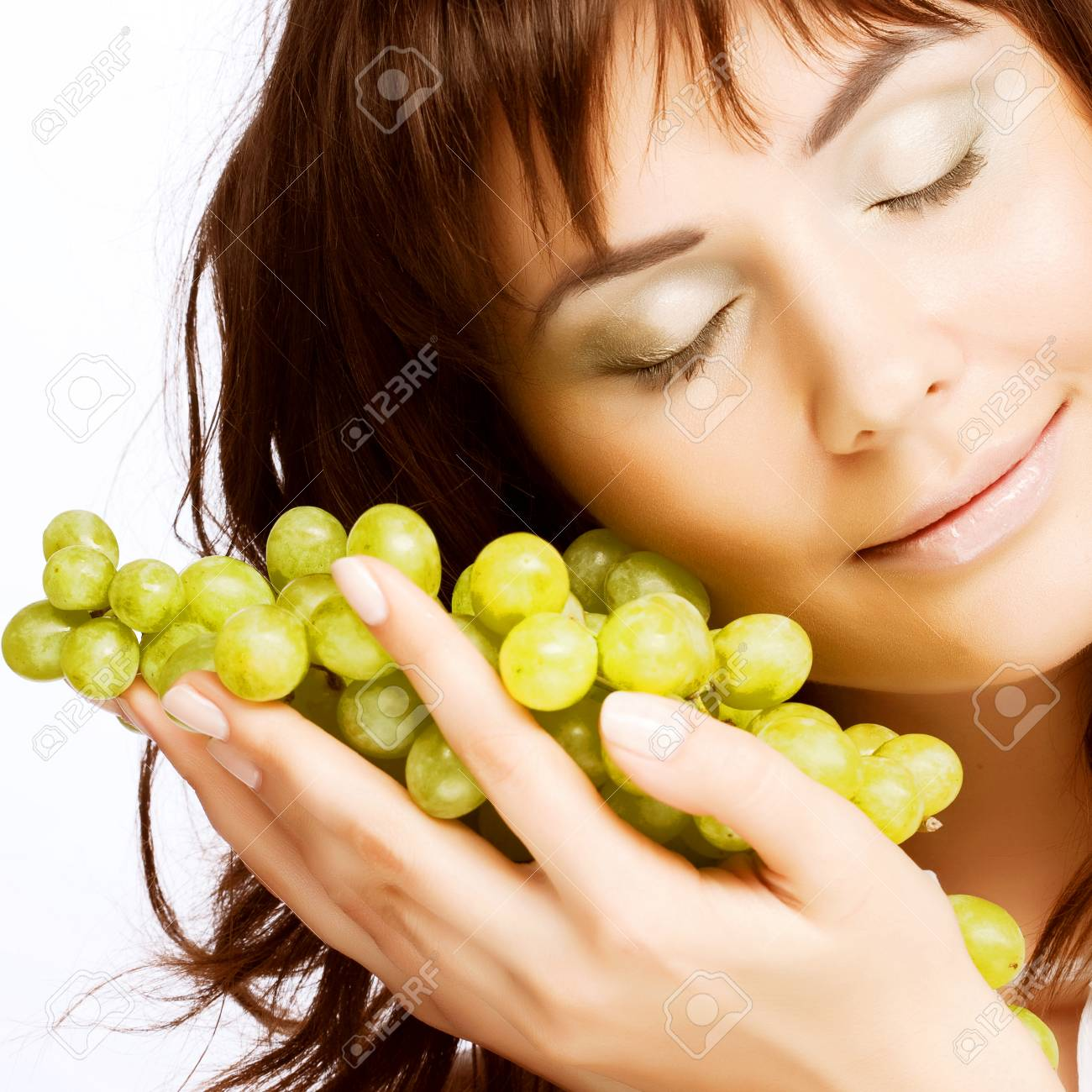 Young Woman With Green Grapes